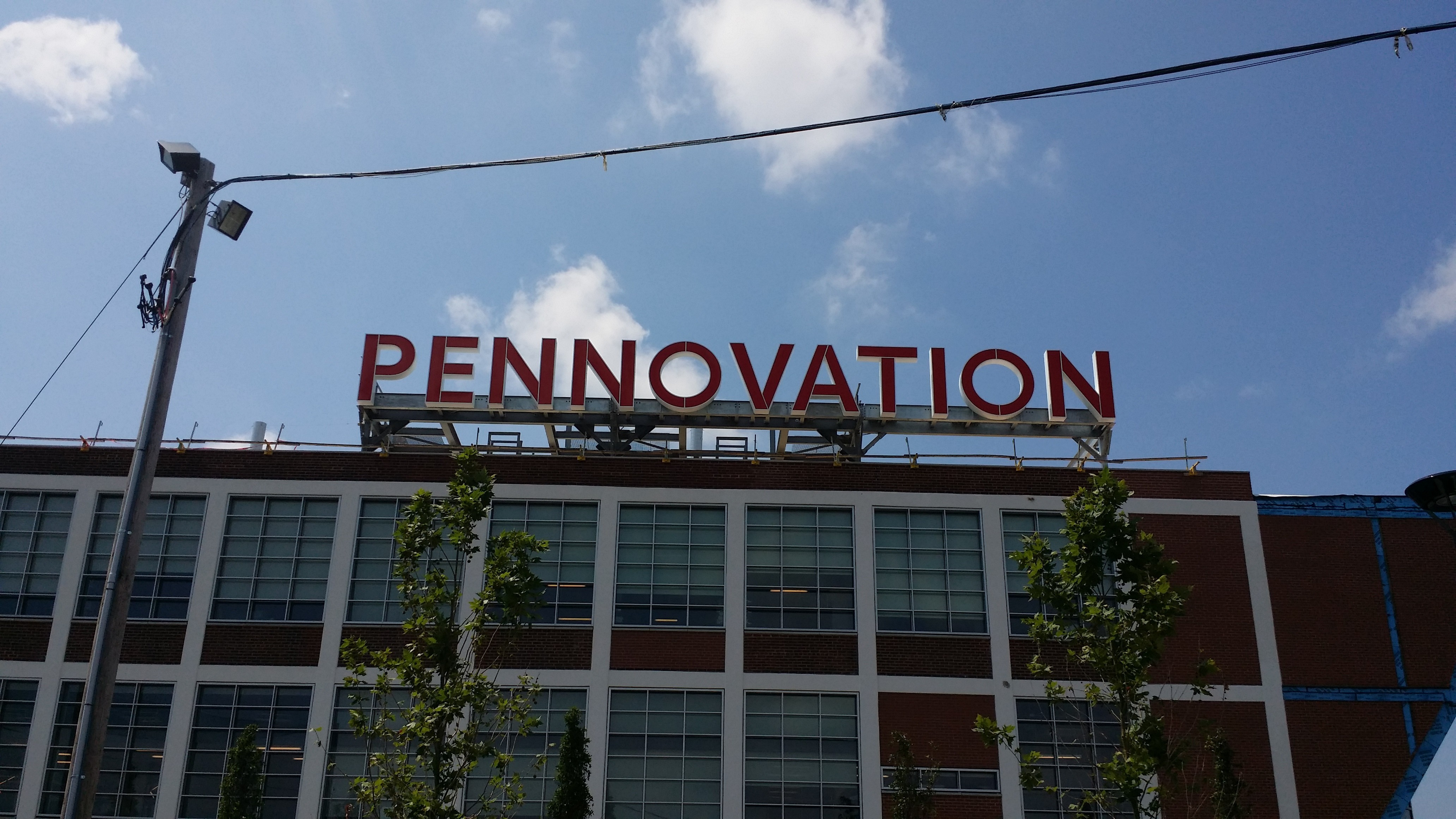 Pennovation lettering on roof as seen from sidewalk