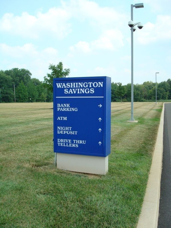 Washington Savings sign with direction arrows