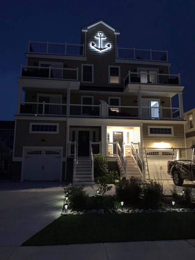 Lit custom anchor sign at night