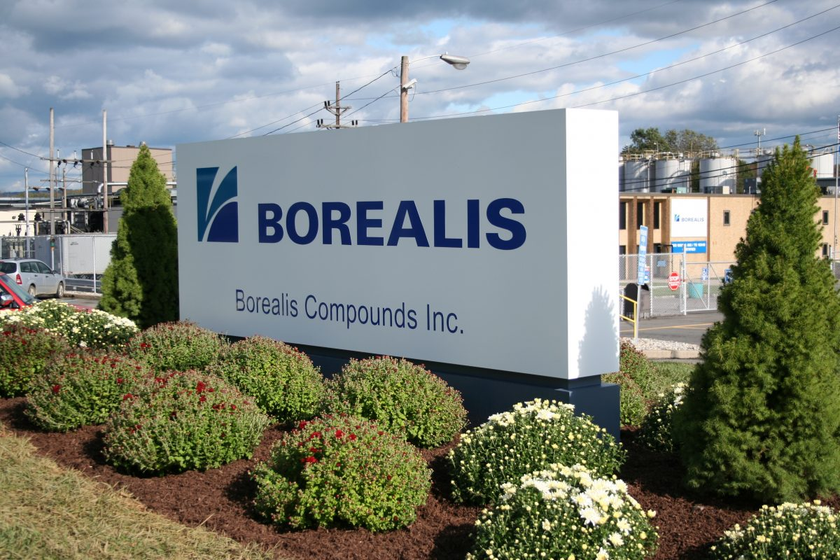 Borealis sign with flowers planted around it