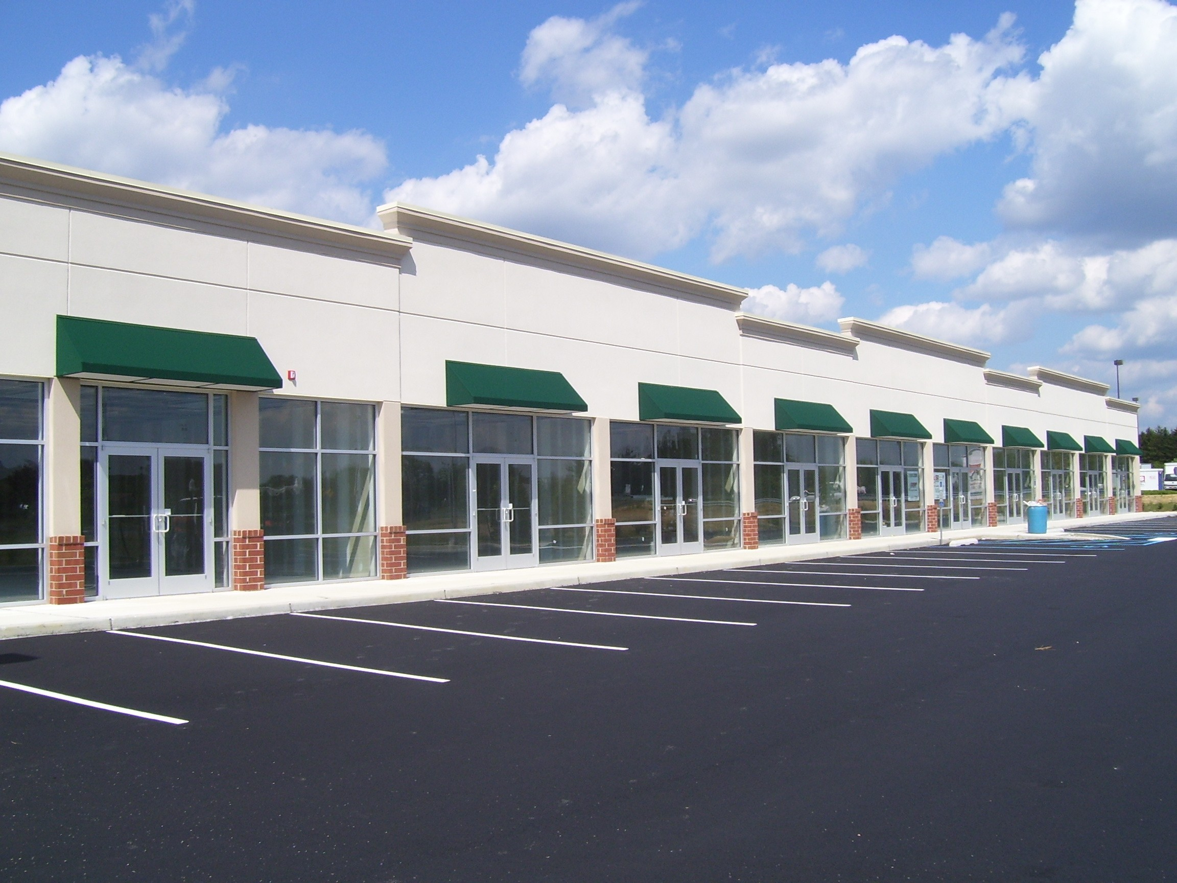 Strip mall with green awnings